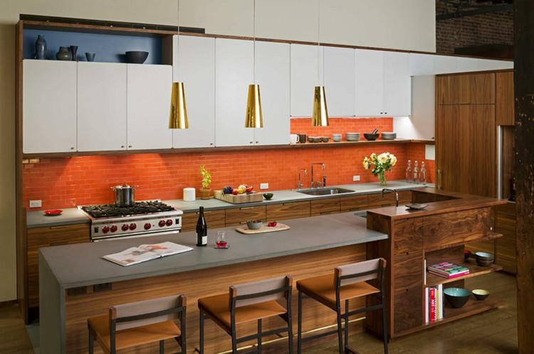 5 cocina con península de estilo vanguardista con barra y espacio de almacenamiento