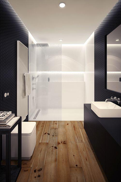 Baño moderno con suelo madera y piezas minimalistas